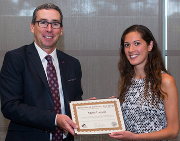 Gordon Hanson presents award to Melia Ungson