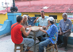 On a recent visit to the eastern portion of Cuba, or El Oriente, Feinberg passes by a gentlemen engaged in a game outside.