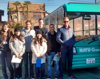 Group in front of electric bus