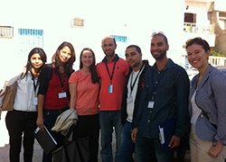 Prather with collaborator, Sarah Bush, and one of their survey teams in Tunisia